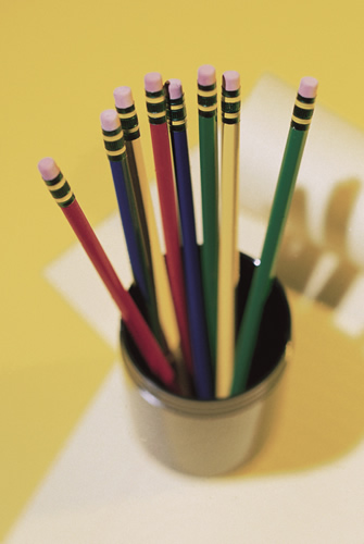 cup of pencils of different colors, eraser end up