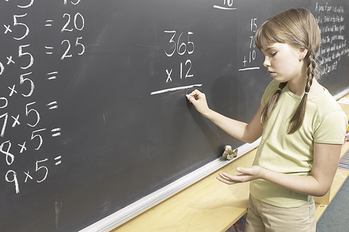 Child at blackboard