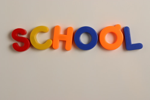 school spelled in colored plastic letters