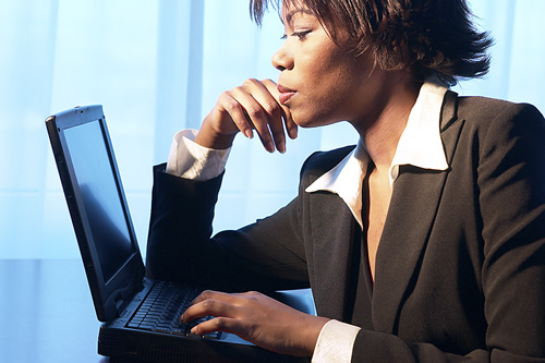woman working in front of a laptop