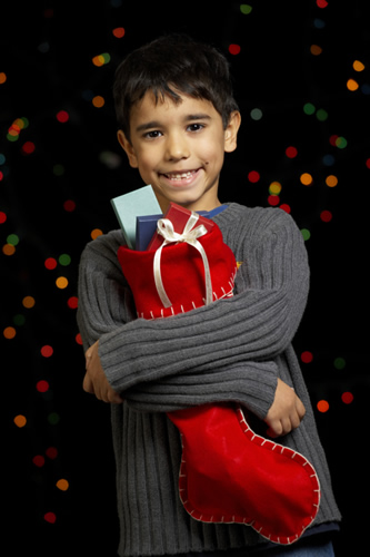 Child holding a Christmas boot