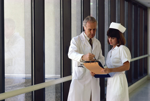 doctor conferring with nurse