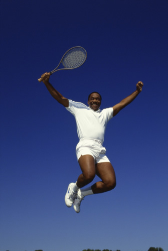 tennis player jumping in air