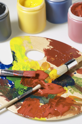 paint palette with red, yellow, and blue paint and 3 paint brushes